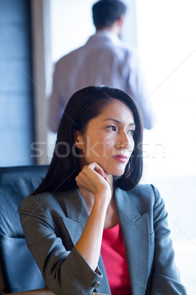 Thoughful businesswoman sitting in office Stock photo © wavebreak_media