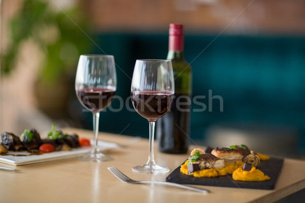 Plate of meal with glass of red wine Stock photo © wavebreak_media