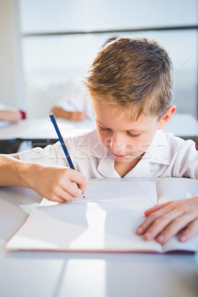 Schooljongen huiswerk klas school boek potlood Stockfoto © wavebreak_media