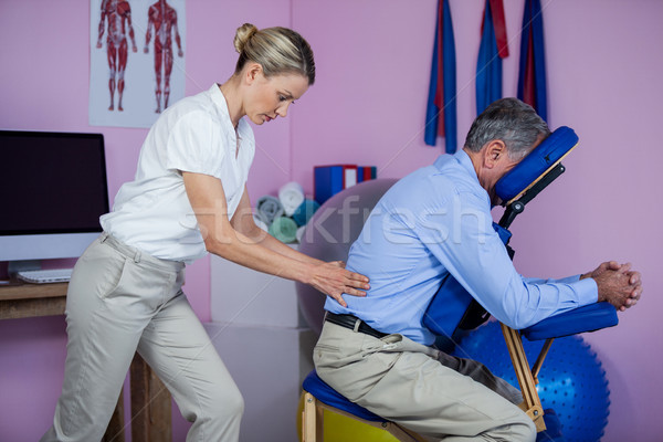 Physiotherapist giving back massage to a patient Stock photo © wavebreak_media