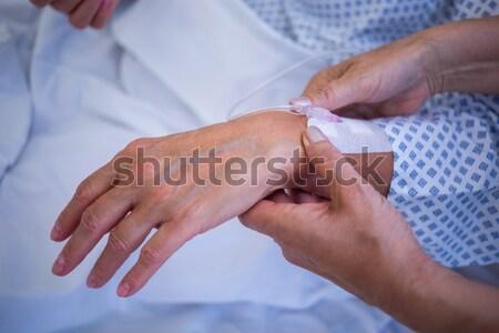 Nurse attaching iv drip on patient s hand Stock photo © wavebreak_media