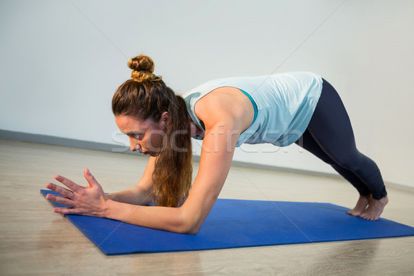 Woman performing yoga on exercise mat Stock photo © wavebreak_media