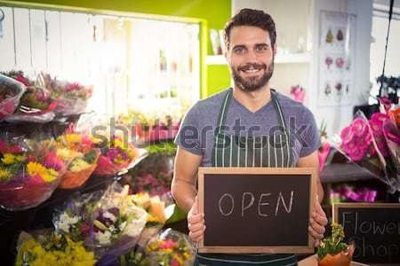 Male florist holding crate of flower bouquet Stock photo © wavebreak_media