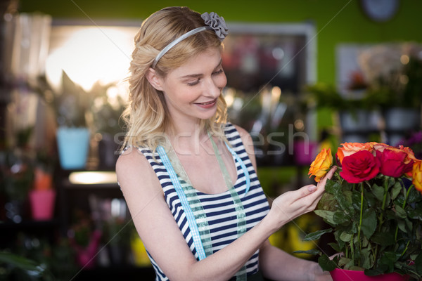 Female florist touching rose flowers Stock photo © wavebreak_media