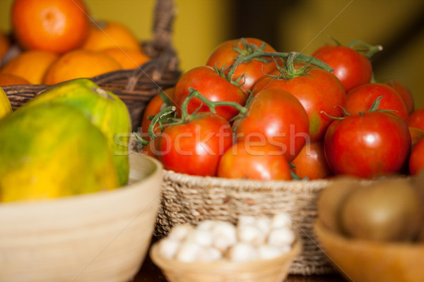 Juicy tomatoes and fruits in organic section Stock photo © wavebreak_media
