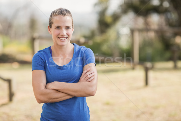 Portrait of smiling woman standing with arms crossed in during obstacle course Stock photo © wavebreak_media