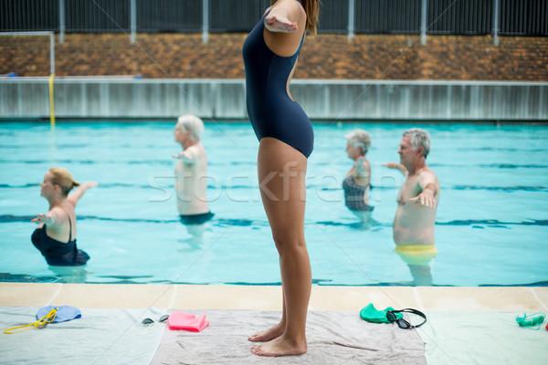 Femenino entrenador altos mujer agua fitness Foto stock © wavebreak_media