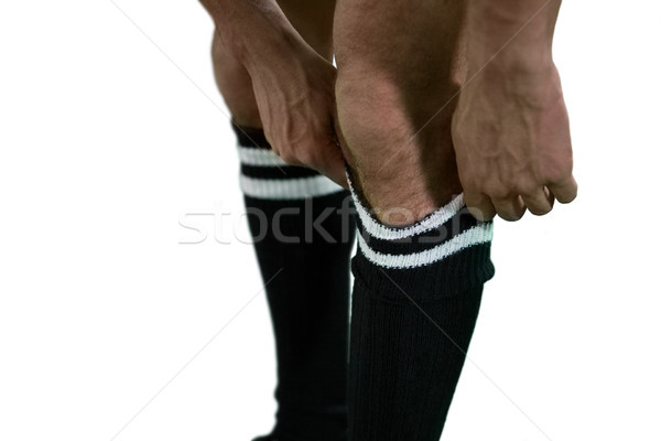 Football player pulling his socks up Stock photo © wavebreak_media