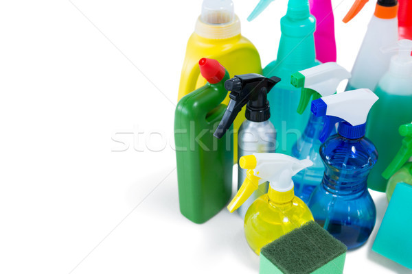 High angel view of colorful spray bottles with sponges and gloves Stock photo © wavebreak_media