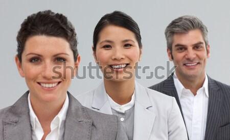 Smiling businessman leading his colleagues Stock photo © wavebreak_media