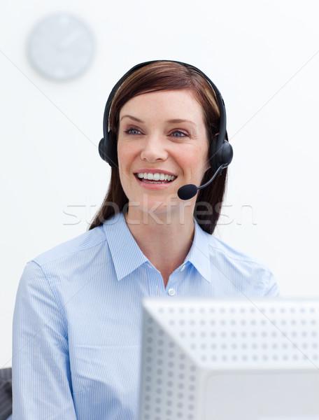 Risonho empresária fone branco escritório internet Foto stock © wavebreak_media