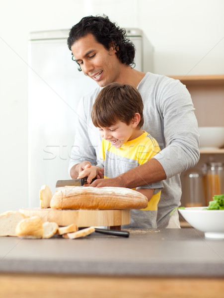 Attentive father helping his son cut some bread Stock photo © wavebreak_media