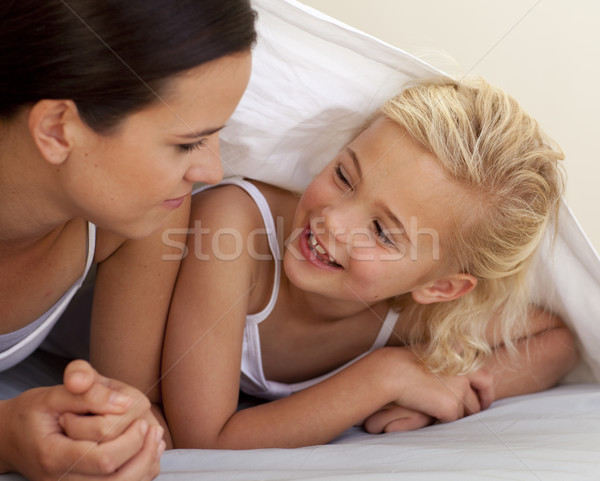 Mother and daughter talking under the bedsheets Stock photo © wavebreak_media