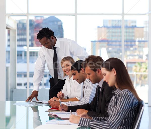 Menedzser dolgozik csapat iroda telefon megbeszélés Stock fotó © wavebreak_media