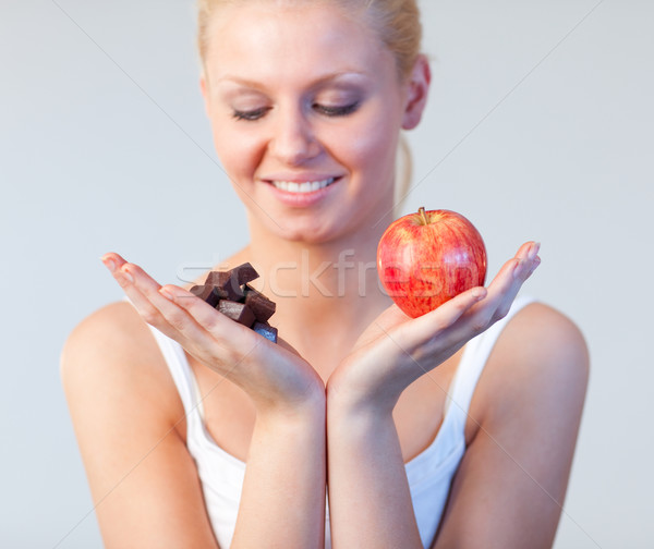 Young woman showing chocolate and apple focus on chocolate and apple  Stock photo © wavebreak_media
