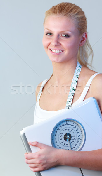 Happy woman holding a scales focus on woman  Stock photo © wavebreak_media