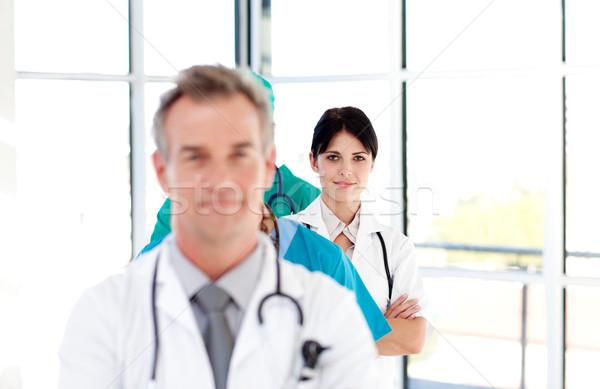 Médecin rangée séduisant femme sourire Photo stock © wavebreak_media