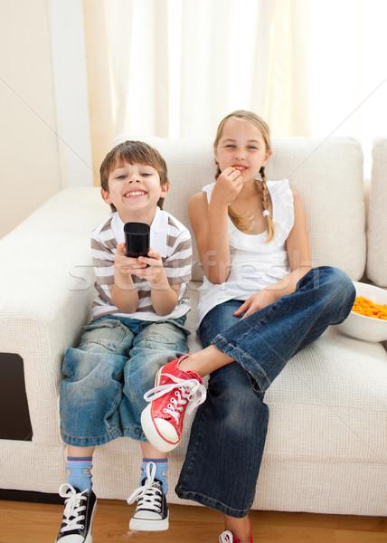 Happy siblings watching TV  Stock photo © wavebreak_media