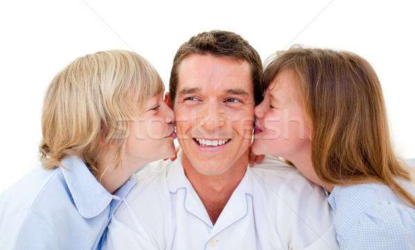 Cute siblings kissing their father against a white background Stock photo © wavebreak_media