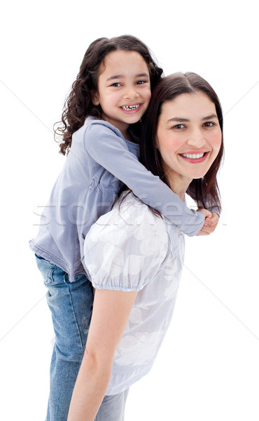 Cheerful mother giving her daughter piggyback ride against a white background Stock photo © wavebreak_media