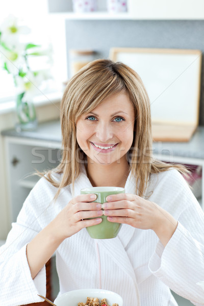 Simper woman with a cup Stock photo © wavebreak_media