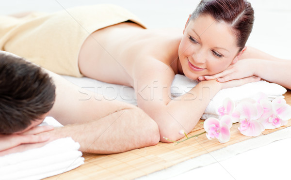 Loving young couple lying on a massage table in a spa center Stock photo © wavebreak_media