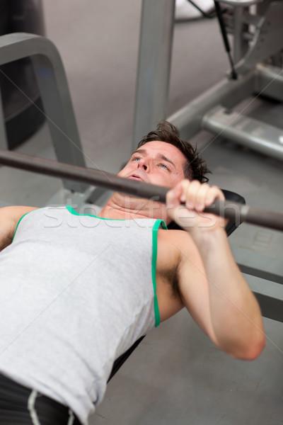 мышечный человека гантели фитнес центр Сток-фото © wavebreak_media