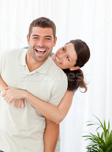 Derűs nő ölel férj áll nappali Stock fotó © wavebreak_media