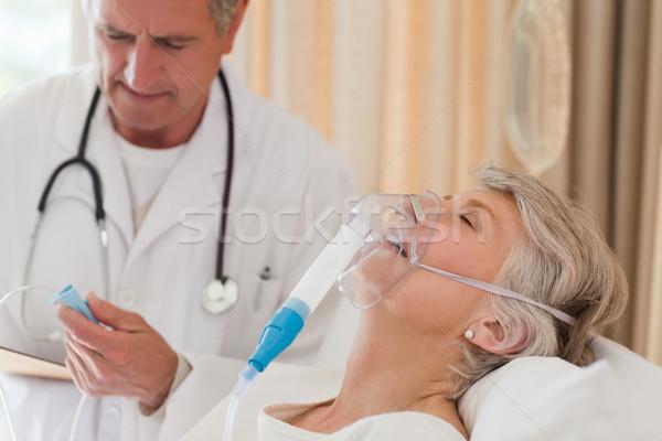 Doctor examining his patient Stock photo © wavebreak_media