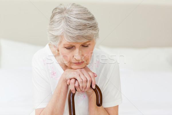 Emeryturę kobieta spaceru Stick domu starszy Zdjęcia stock © wavebreak_media