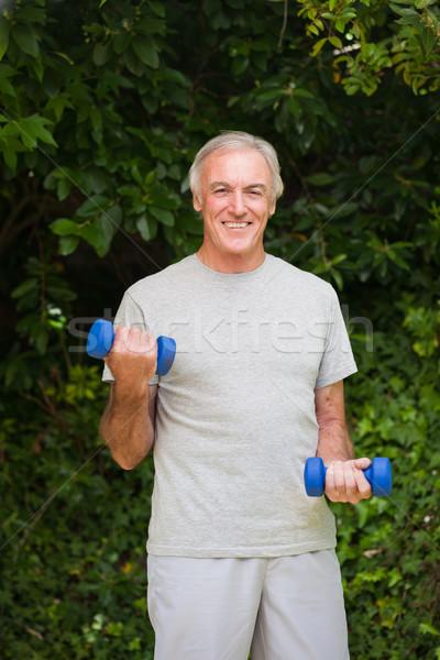 Senior man doing his exercises in the garden Stock photo © wavebreak_media