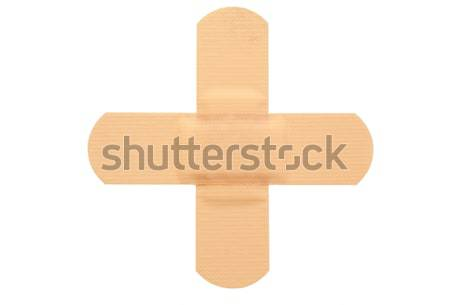 Stuck band-aid on a white background Stock photo © wavebreak_media