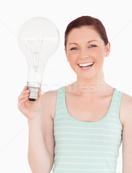 Káprázatos női tart villanykörte áll fehér Stock fotó © wavebreak_media