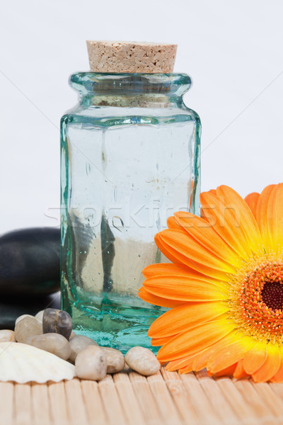 A glass flask with round smooth pebbles and a sunflower Stock photo © wavebreak_media