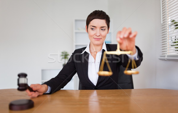 Young woman with a gavel and the justice scale in her office Stock photo © wavebreak_media