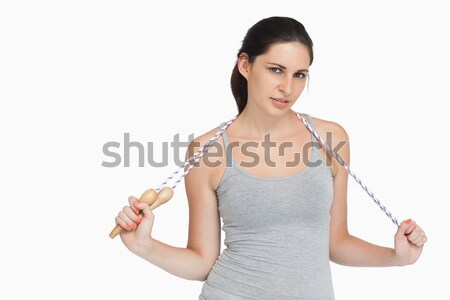 Stock photo: Good looking woman posing with her thumbs while standing against a white background