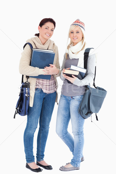 Two cute female students with books prepared for winter Stock photo © wavebreak_media