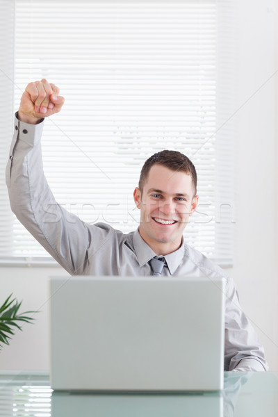 Close up of young businessman getting awesome news via email Stock photo © wavebreak_media
