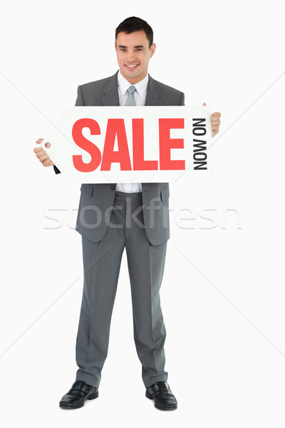 Stock photo: Businessman with signboard against a white background