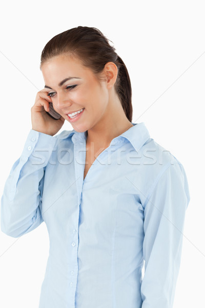 Stock photo: Young businesswoman on the phone against a white background