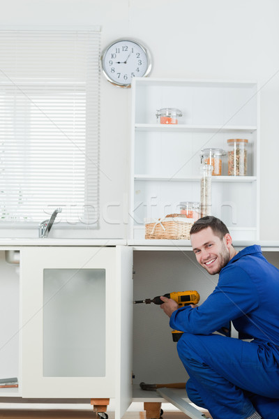 портрет улыбаясь мастер на все руки двери кухне Сток-фото © wavebreak_media