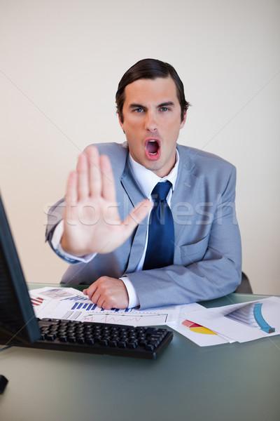 Sitting businessman yelling stop Stock photo © wavebreak_media