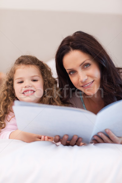 Young mother and daughter reading bedtime stories together Stock photo © wavebreak_media