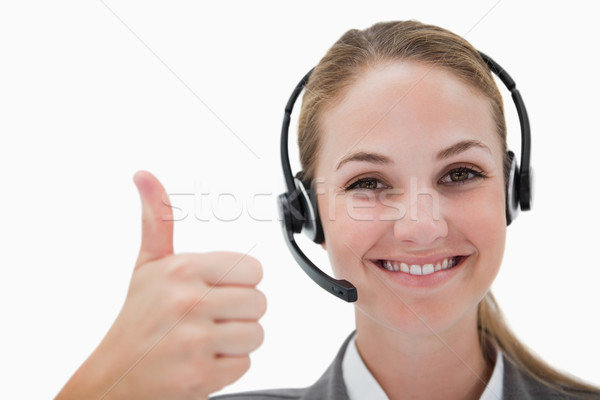 Sorridente call center agente polegar para cima branco Foto stock © wavebreak_media