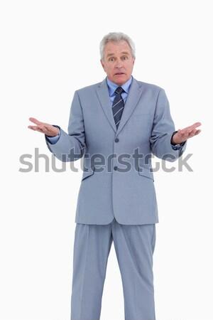 Irritated mature tradesman against a white background Stock photo © wavebreak_media