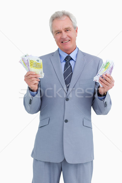 Mature tradesman showing his profit against a white background Stock photo © wavebreak_media