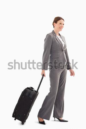 улыбаясь деловая женщина чемодан ходьбе бизнеса моде Сток-фото © wavebreak_media