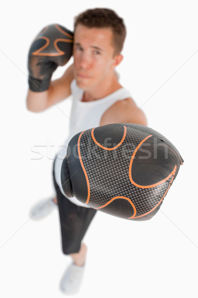 Stock photo: High angle view of boxer against a white background