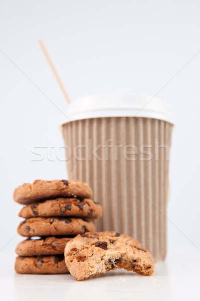 Five cookies and an half eaten cookie and a cup of coffee placed together against a white background Stock photo © wavebreak_media