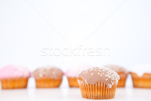 Muffinok porcukor vonal fehér háttér eszik Stock fotó © wavebreak_media